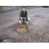 David Goodall inspects just one of the many potholes appearing on Southampton's patched road network