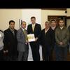 "David Goodall at the Fellowship Dialogue Society receiving a book after giving a speech on ""Creating a fair and green Britain"""