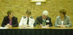 Cllr Cathie Fraser (left) and West End Parish Clerk Laura Cooke look on as Chief Superintendent Ann Wakefield and West End Parish Chairman Neville Dickinson sign and seal the deal