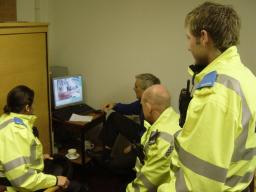 The West End Police team studying CCTV footage