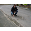 David Goodall with one of the many potholes reported to Hampshire County Council to be fixed
