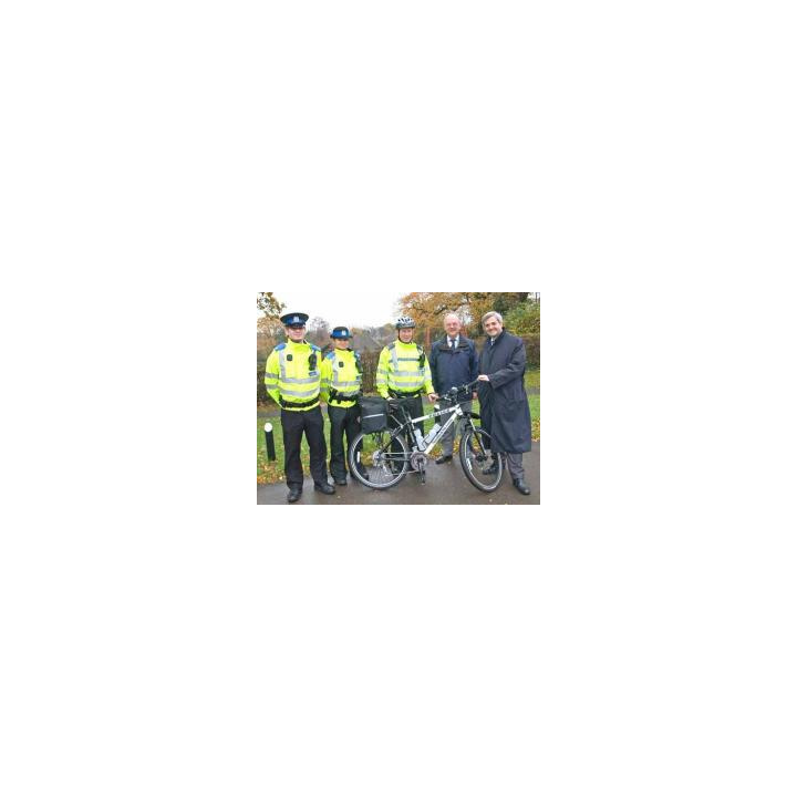 PCSOs Ed Pritt and Michelle Towle and PC Gavin Smith receive one of two new bikes from the Borough's Community Safety Partnership Manager, Peter Baldry and Eastleigh MP Chris Huhne