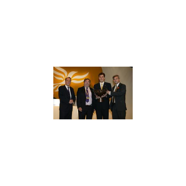 Party President Simon Hughes MP presents the award to David Chidgey MP, local party Chairman Cllr David Goodall & Chris Huhne MEP.
