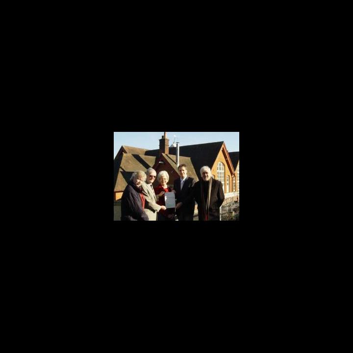 Cllr David Goodall presents the cheque to Hilldene Community Association Chairman Ken Morris
