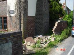 Wall smashed after accident near Wesley House in Burnetts Lane